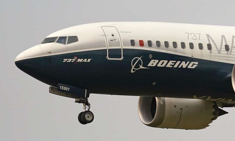 Boeing says pandemic will cut demand for planes for a decade