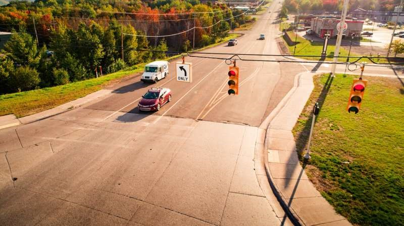 Cooperative eco-driving automation improves energy efficiency and safety